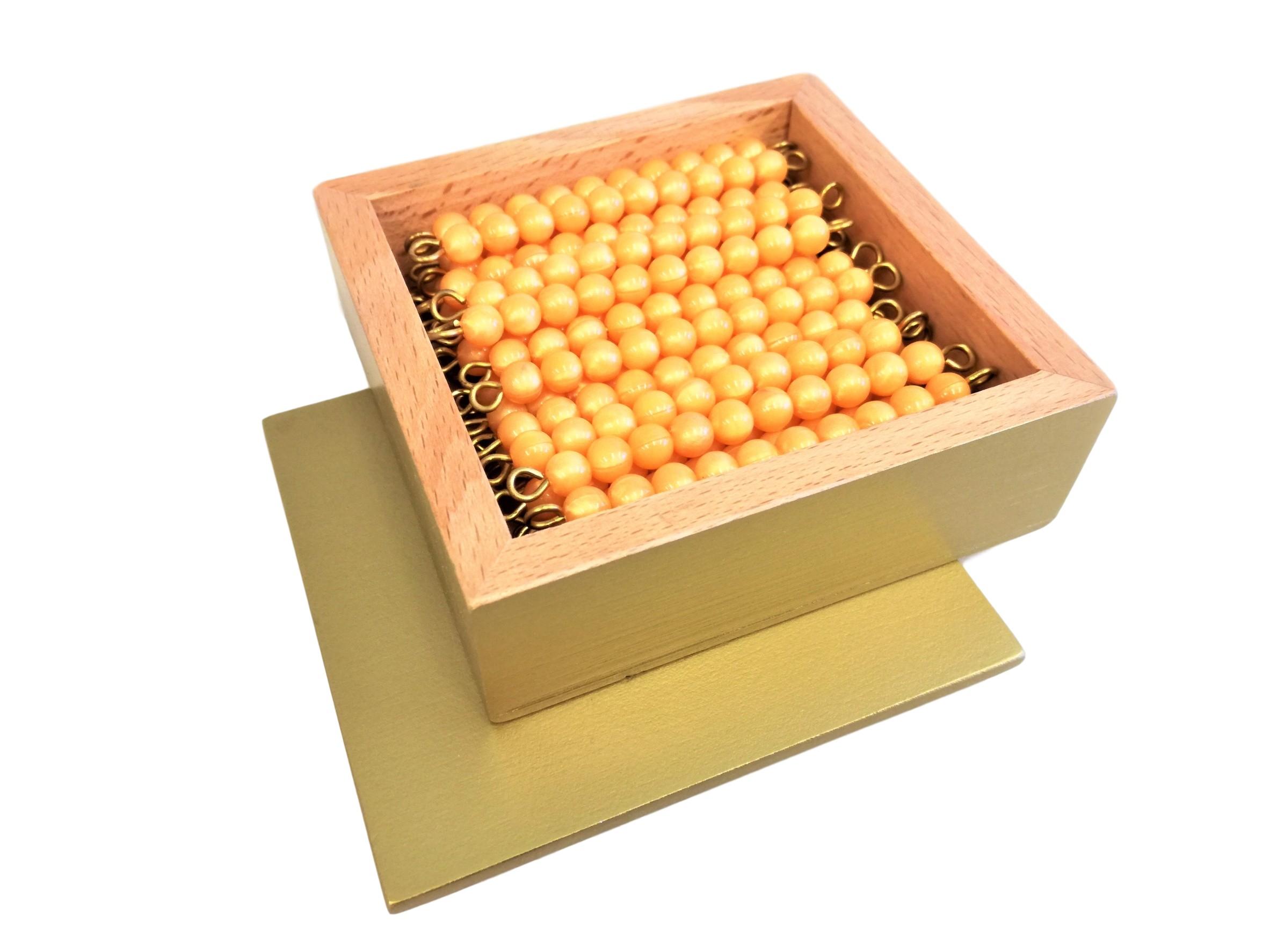 45 ks zlatých desítek v dřevěné krabičce